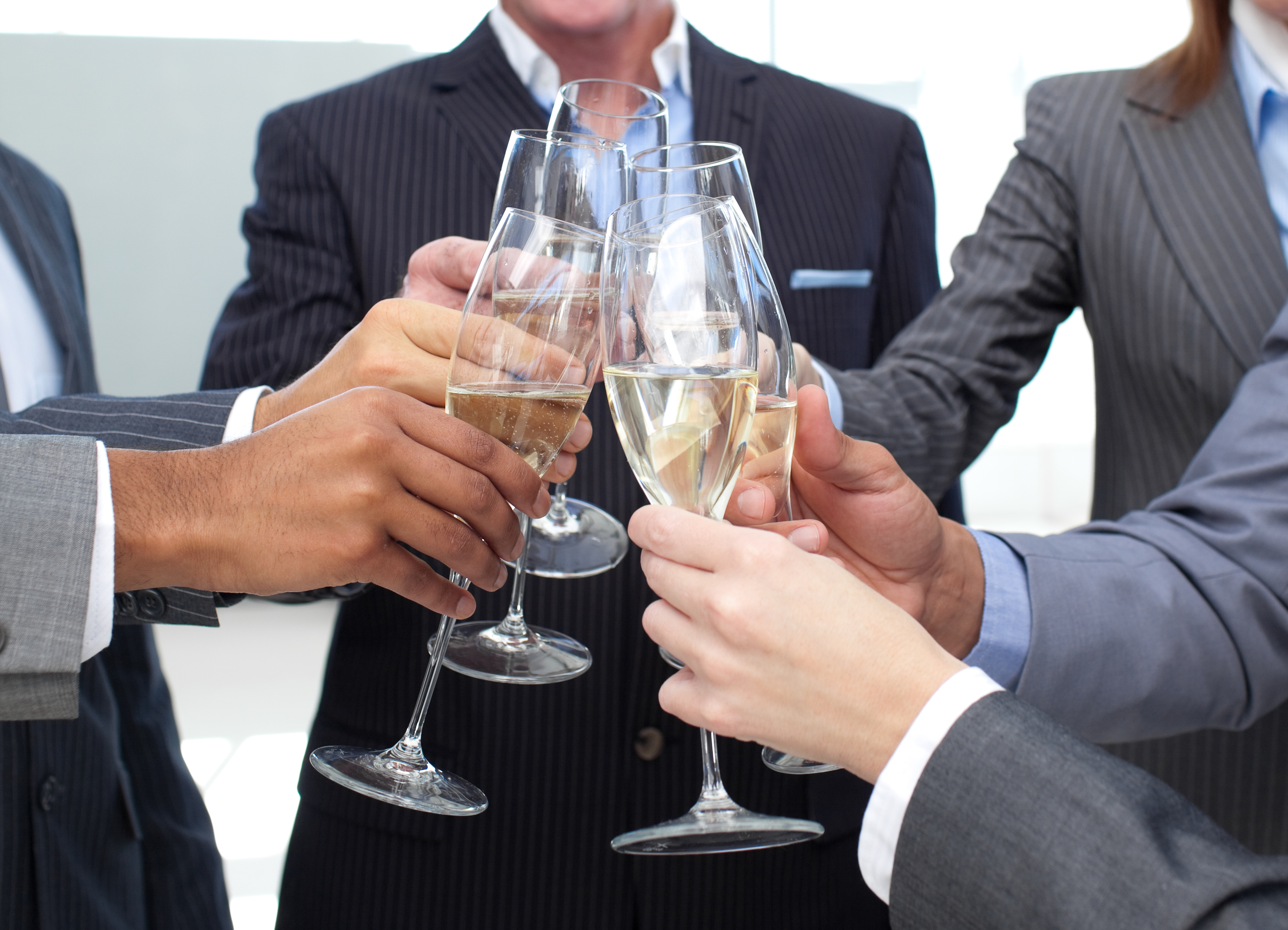 Close-up of business team toasting with Champagne at webster groves restaurants